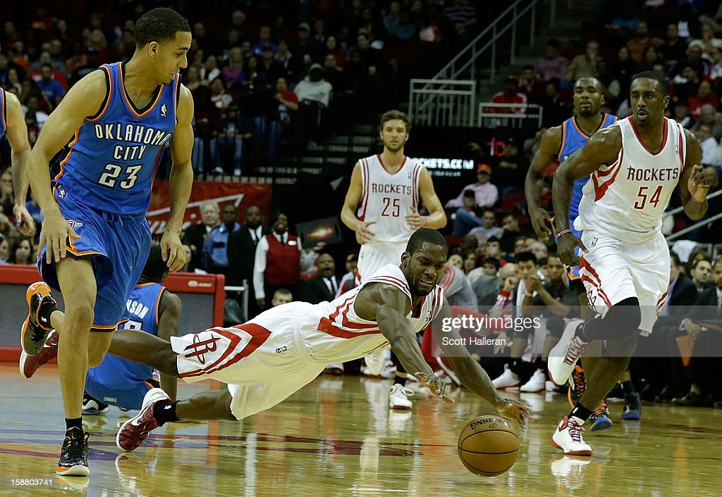 Toney Douglas #15 of the Houston Rockets dives for a ball against the Oklahoma City Thunder at the Toyota Center on December 29, 2012 in Houston, Texas.
