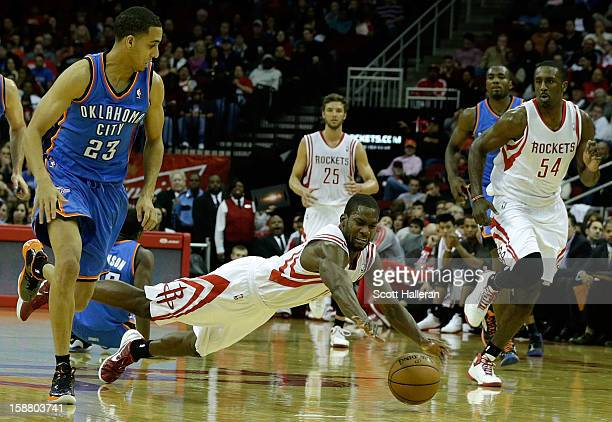 Toney Douglas of the Houston Rockets dives for a ball against the Oklahoma City Thunder at the Toyota Center on December 29 2012 in Houston Texas...