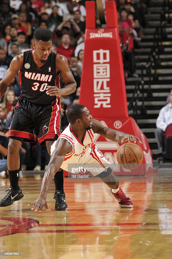 Toney Douglas #15 of the Houston Rockets dribbles the ball upcourt against Norris Cole #30 of the Miami Heat on November 12, 2012 at the Toyota Center in Houston, Texas.