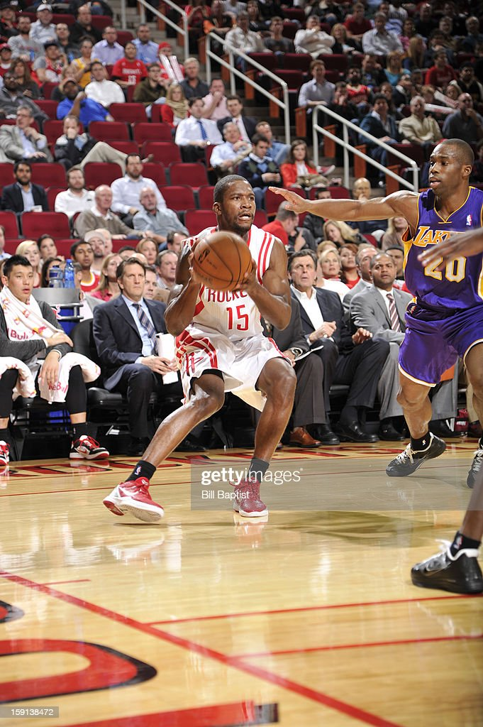 Toney Douglas #15 of the Houston Rockets drives against Jodie Meeks #20 of the Los Angeles Lakers on January 8, 2013 at the Toyota Center in Houston, Texas.
