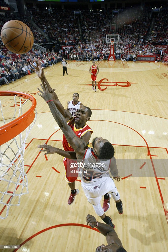 Toney Douglas #15 of the Houston Rockets drives to the basket against the Atlanta Hawks on December 31, 2012 at the Toyota Center in Houston, Texas.