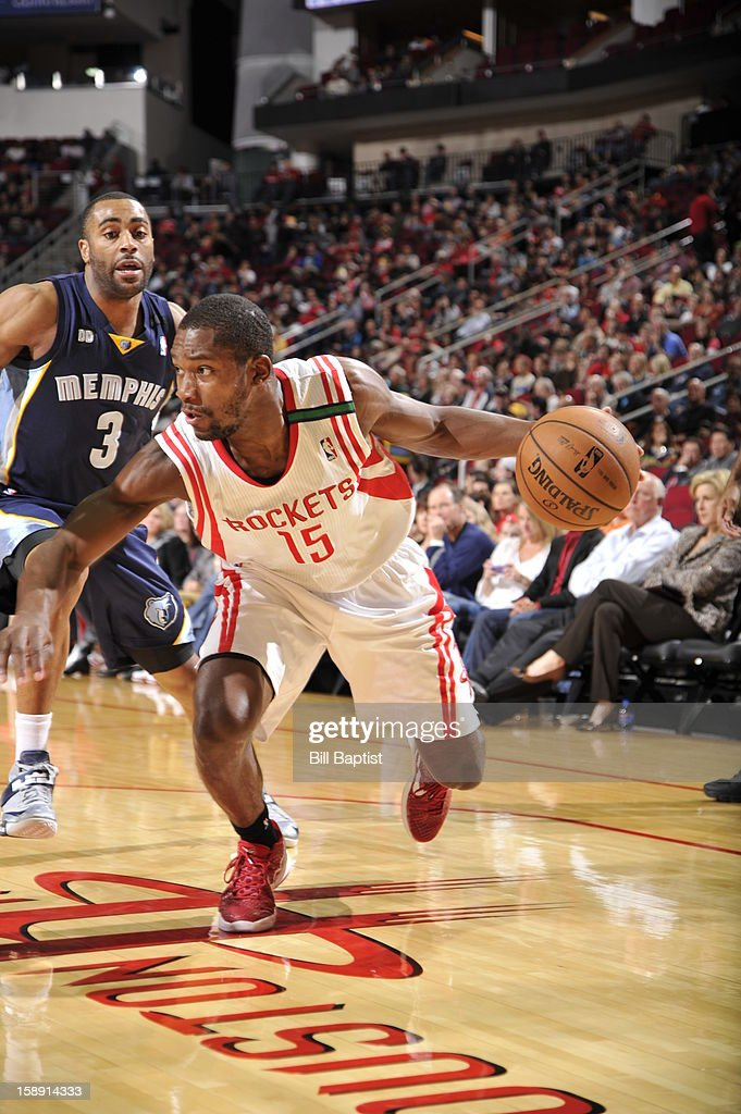 <a gi-track='captionPersonalityLinkClicked' href=/galleries/search?phrase=Toney+Douglas&family=editorial&specificpeople=2536966 ng-click='$event.stopPropagation()'>Toney Douglas</a> #15 of the Houston Rockets drives to the basket against the Memphis Grizzlies on December 22, 2012 at the Toyota Center in Houston, Texas.