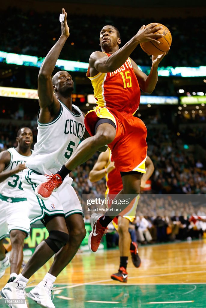 Toney Douglas #15 of the Houston Rockets goes up for a layup against Kevin Garnett #5 of the Boston Celtics during the game on January 11, 2013 at TD Garden in Boston, Massachusetts.