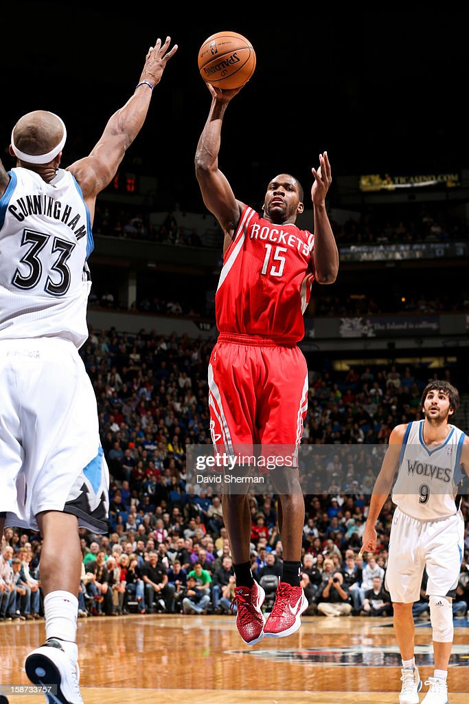 Toney Douglas #15 of the Houston Rockets looks to pass the ball against Dante Cunningham #33 of the Minnesota Timberwolves on December 26, 2012 at Target Center in Minneapolis, Minnesota.