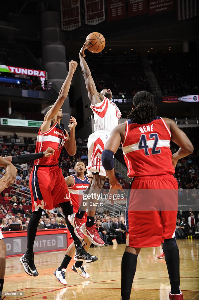 Toney Douglas #15 of the Houston Rockets rebounds the ball against Shaun Livingston #14 of the Washington Wizards on December 12, 2012 at the Toyota Center in Houston, Texas.