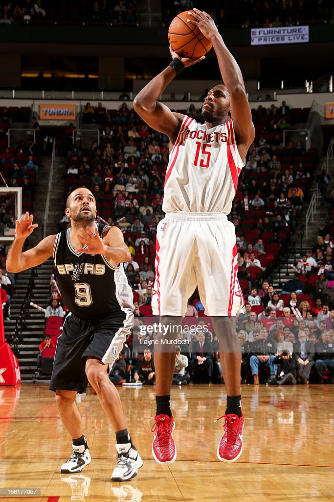 <a gi-track='captionPersonalityLinkClicked' href=/galleries/search?phrase=Toney+Douglas&family=editorial&specificpeople=2536966 ng-click='$event.stopPropagation()'>Toney Douglas</a> #15 of the Houston Rockets shoots against Tony Parker #9 of the San Antonio Spurs on December 10, 2012 at the Toyota Center in Houston, Texas.