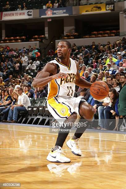 Toney Douglas of the Indiana Pacers handles the ball against the Detroit Pistons during a preseason game on October 13 2015 at Bankers Life...