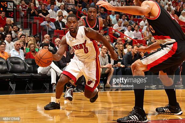 Toney Douglas of the Miami Heat dribbles the ball during the game against the Portland Trail Blazers at the American Airlines Arena in Miami Florida...