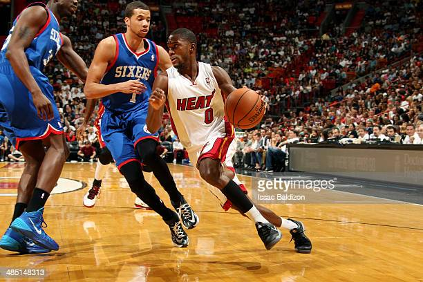 Toney Douglas of the Miami Heat drives against the Philadelphia 76ers at the American Airlines Arena in Miami Florida on April 16 2014 NOTE TO USER...