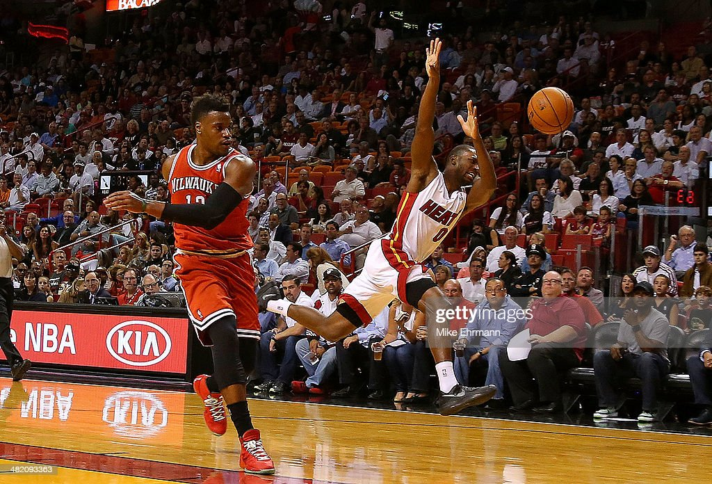 <a gi-track='captionPersonalityLinkClicked' href=/galleries/search?phrase=Toney+Douglas&family=editorial&specificpeople=2536966 ng-click='$event.stopPropagation()'>Toney Douglas</a> #0 of the Miami Heat is fouled by <a gi-track='captionPersonalityLinkClicked' href=/galleries/search?phrase=Jeff+Adrien&family=editorial&specificpeople=727235 ng-click='$event.stopPropagation()'>Jeff Adrien</a> #12 of the Milwaukee Bucks during a game at American Airlines Arena on April 2, 2014 in Miami, Florida.