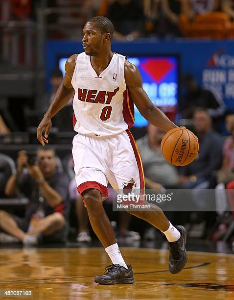 Toney Douglas of the Miami Heat looks to pass during a game against the Milwaukee Bucks at American Airlines Arena on April 2 2014 in Miami Florida...