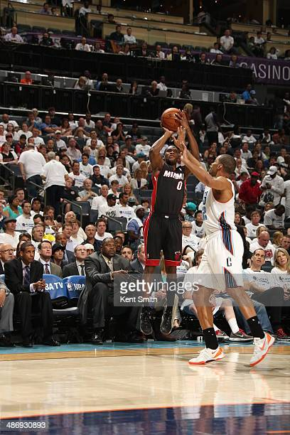 Toney Douglas of the Miami Heat shoots against the Charlotte Bobcats during Game Three of the Eastern Conference Quarterfinals of the 2014 NBA...