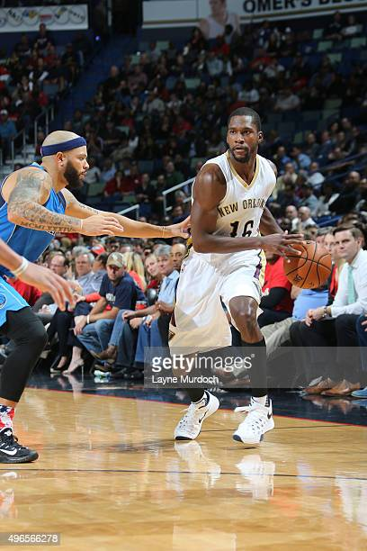 Toney Douglas of the New Orleans Pelicans defends the ball against the Dallas Mavericks during the game on November 10 2015 at Smoothie King Center...
