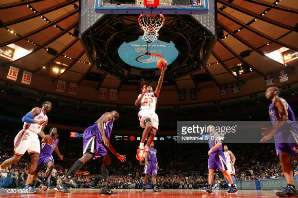 Toney Douglas of the New York Knicks shoots against Sam Dalembert of the Sacramento Kings during a game on January 14 2011 at Madison Square Garden...