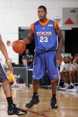 Toney Douglas of the New York Knicks surveys the court against the Detroit Pistons during NBA Summer League presented by EA Sports on July 15 2009 at...