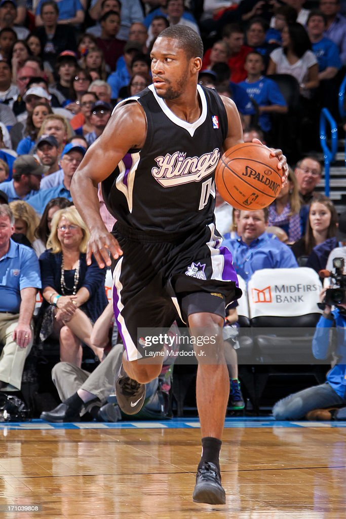 <a gi-track='captionPersonalityLinkClicked' href=/galleries/search?phrase=Toney+Douglas&family=editorial&specificpeople=2536966 ng-click='$event.stopPropagation()'>Toney Douglas</a> #0 of the Sacramento Kings advances the ball against the Oklahoma City Thunder on April 15, 2013 at the Chesapeake Energy Arena in Oklahoma City, Oklahoma.