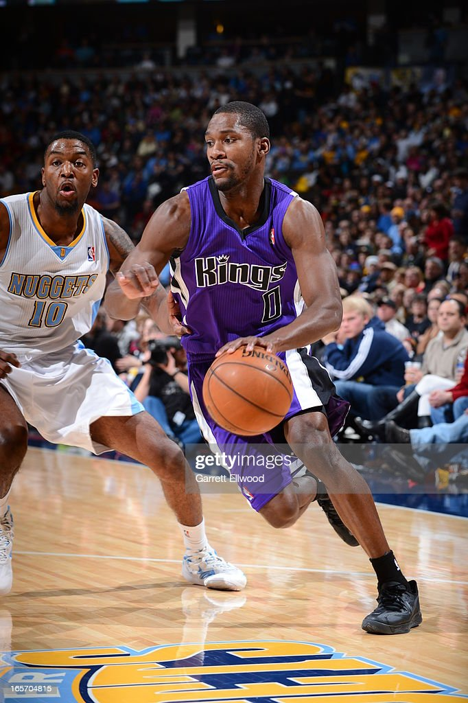 <a gi-track='captionPersonalityLinkClicked' href=/galleries/search?phrase=Toney+Douglas&family=editorial&specificpeople=2536966 ng-click='$event.stopPropagation()'>Toney Douglas</a> #0 of the Sacramento Kings drives to the basket against the Denver Nuggets on March 23, 2012 at the Pepsi Center in Denver, Colorado.