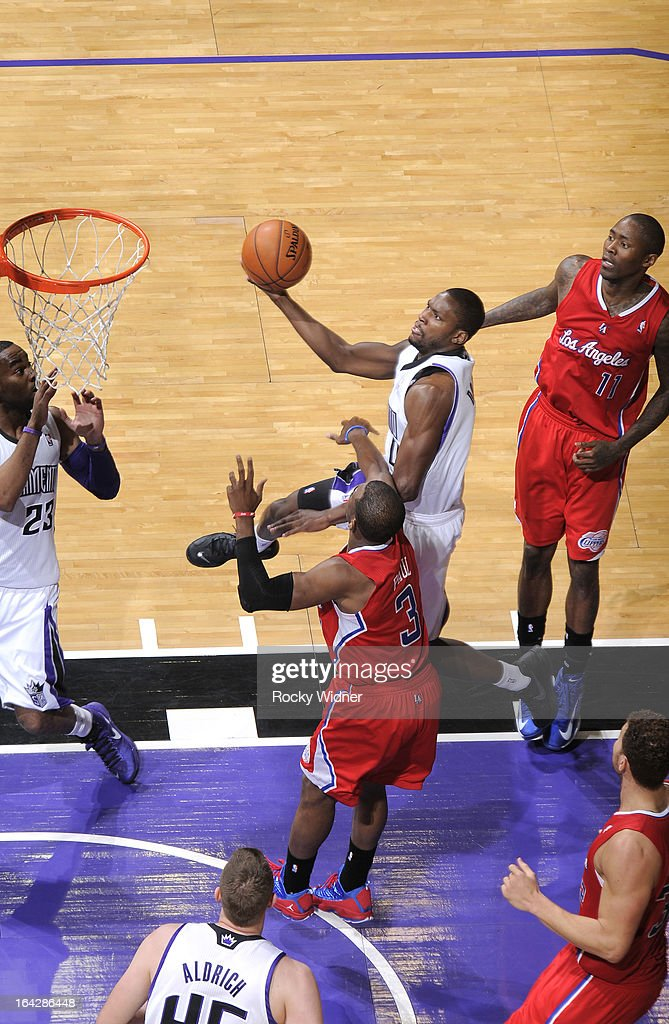 <a gi-track='captionPersonalityLinkClicked' href=/galleries/search?phrase=Toney+Douglas&family=editorial&specificpeople=2536966 ng-click='$event.stopPropagation()'>Toney Douglas</a> #0 of the Sacramento Kings shoots against <a gi-track='captionPersonalityLinkClicked' href=/galleries/search?phrase=Chris+Paul&family=editorial&specificpeople=212762 ng-click='$event.stopPropagation()'>Chris Paul</a> #3 of the Los Angeles Clippers on March 19, 2013 at Sleep Train Arena in Sacramento, California.