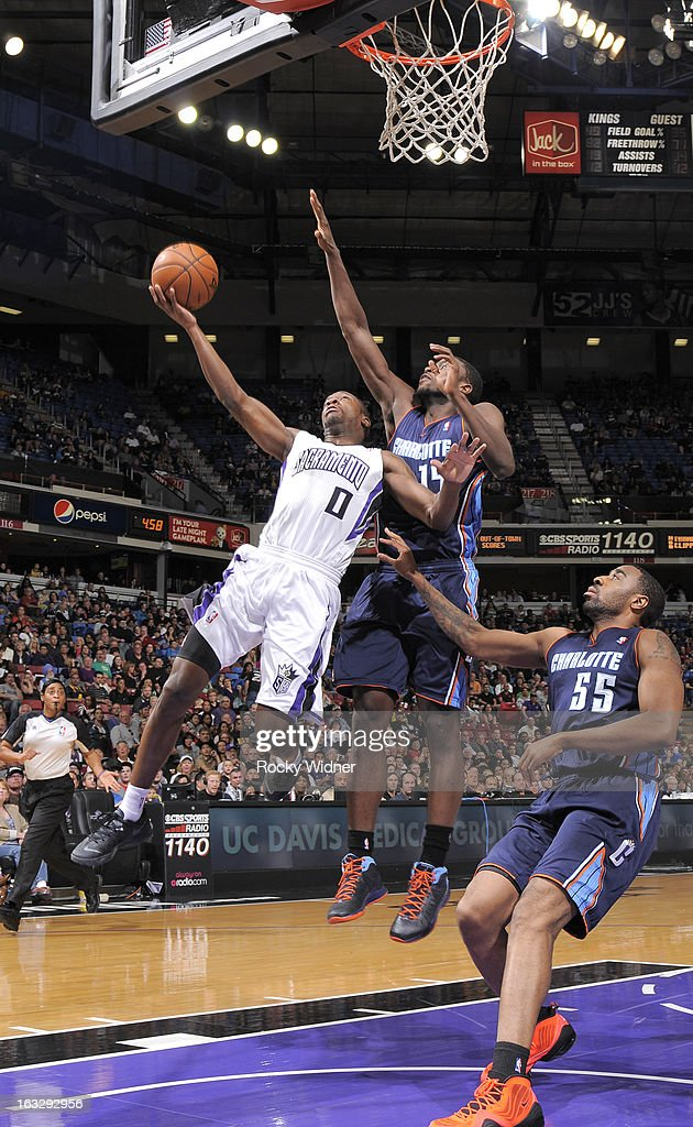 <a gi-track='captionPersonalityLinkClicked' href=/galleries/search?phrase=Toney+Douglas&family=editorial&specificpeople=2536966 ng-click='$event.stopPropagation()'>Toney Douglas</a> #0 of the Sacramento Kings shoots against <a gi-track='captionPersonalityLinkClicked' href=/galleries/search?phrase=Michael+Kidd-Gilchrist&family=editorial&specificpeople=8526214 ng-click='$event.stopPropagation()'>Michael Kidd-Gilchrist</a> #14 of the Charlotte Bobcats on March 3, 2013 at Sleep Train Arena in Sacramento, California.
