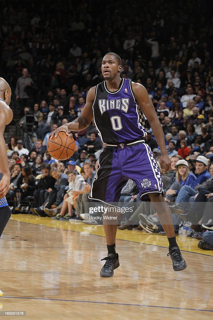 <a gi-track='captionPersonalityLinkClicked' href=/galleries/search?phrase=Toney+Douglas&family=editorial&specificpeople=2536966 ng-click='$event.stopPropagation()'>Toney Douglas</a> #0 of the Sacramento Kings surveys the defense of the Golden State Warriors on March 6, 2013 at Oracle Arena in Oakland, California.