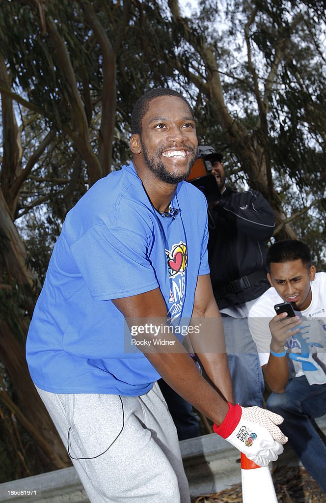 Toney Douglas visits with some volunteers during a break in their clean up of McLaren park during Warriors Day Of Service as part of NBA Cares Week Of Service on October 21, 2013 in San Francisco, California.