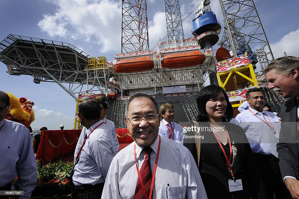Tong Chong Heong, chief executive officer of Keppel Offshore & Marine Ltd., center, stands in front of the Transocean Siam Driller jackup rig, built for Transocean Ltd. by Keppel Corp., during a naming ceremony at the Keppel FELS shipyard in Singapore, on Saturday, Feb. 2, 2013. Keppel Corp.'s FELS unit received a combined $1.5 million bonus for completing the construction of two drilling rigs ahead of time, the company said in a statement. Photographer: Munshi Ahmed/Bloomberg via Getty Images