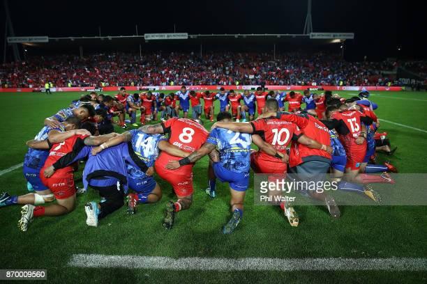 Tonga and Samoa pray following the 2017 Rugby League World Cup match between Samoa and Tonga at Waikato Stadium on November 4 2017 in Hamilton New...