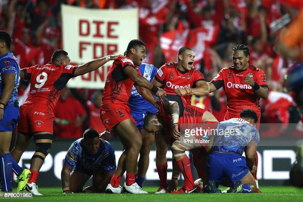 Tonga celebrate a try to Ben MurdochMasila during the 2017 Rugby League World Cup match between Samoa and Tonga at Waikato Stadium on November 4 2017...