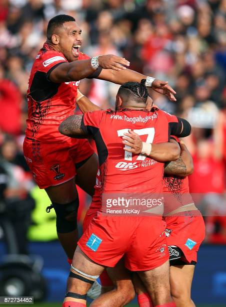 Tonga celebrate the try of Will Hopoate during the 2017 Rugby League World Cup match between the New Zealand Kiwis and Tonga at Waikato Stadium on...