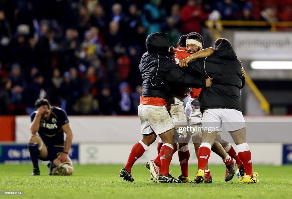 Tonga celebrate their victory following final whistle in the International rugby union test match between Scotland and Tonga at Pittodrie in Aberdeen on November 24, 2012. Tonga beat Scotland 21-15.