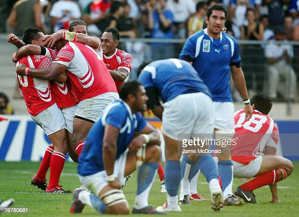 Tonga celebrate their win after match eighteen of the Rugby World Cup 2007 between Samoa and Tonga at the Stade de le Mosson on September 16 2007 in...