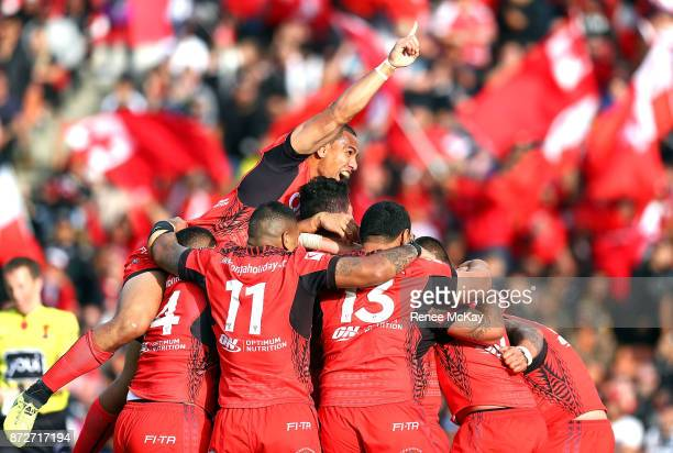 Tonga celebrates during the 2017 Rugby League World Cup match between the New Zealand Kiwis and Tonga at Waikato Stadium on November 11 2017 in...