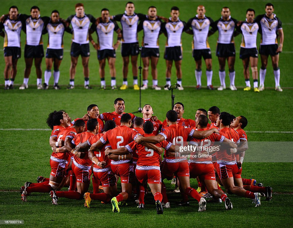Tonga perform the sipi tau in front of the Cook Island prior to the Rugby League World Cup GroupC/D match between Tonga and Cook Islands at Leigh Sports Village on November 5, 2013 in Leigh, Greater Manchester.