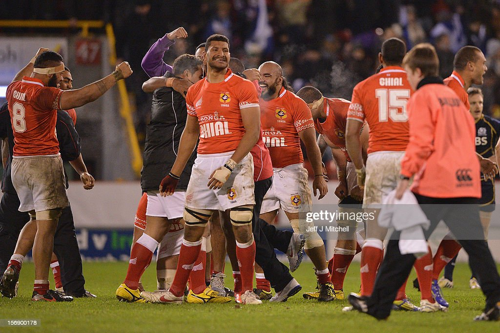Tonga players celebrate at the end of the international match between Scotland and Tonga at Pittodrie stadium on November 24, 2012 in Aberdeen,Scotland.