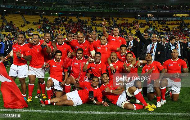 Tonga players celebrate their 1419 victory following the final whistle during the IRB 2011 Rugby World Cup Pool A match between France and Tonga at...