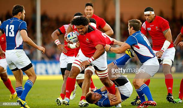 Tonga replacement Opeti Fonua barges through the tackle of Johan Deysel of Namibia during the 2015 Rugby World Cup Pool C match between Tonga and...