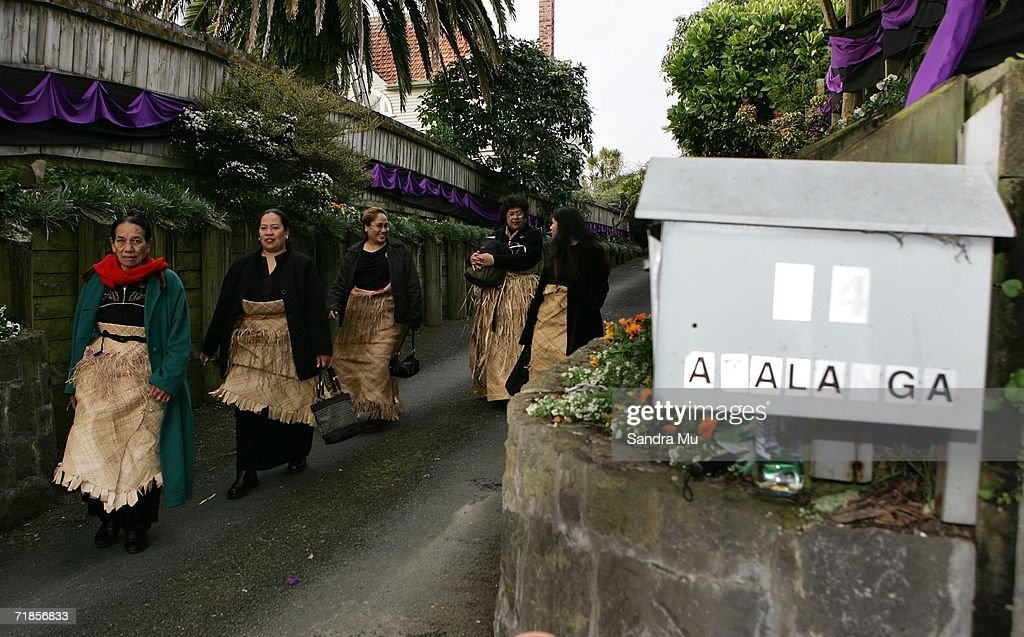 Tongan mourners leave the Royal premises after paying their respects to the Late King of Tonga, Taufa'ahau Tupou IV in Epson, September 12, 2006 in Auckland, New Zealand. The body of the Late King will lie in state at his Auckland residence Atalanga before flying back to Tonga tomorrow for a state funeral.