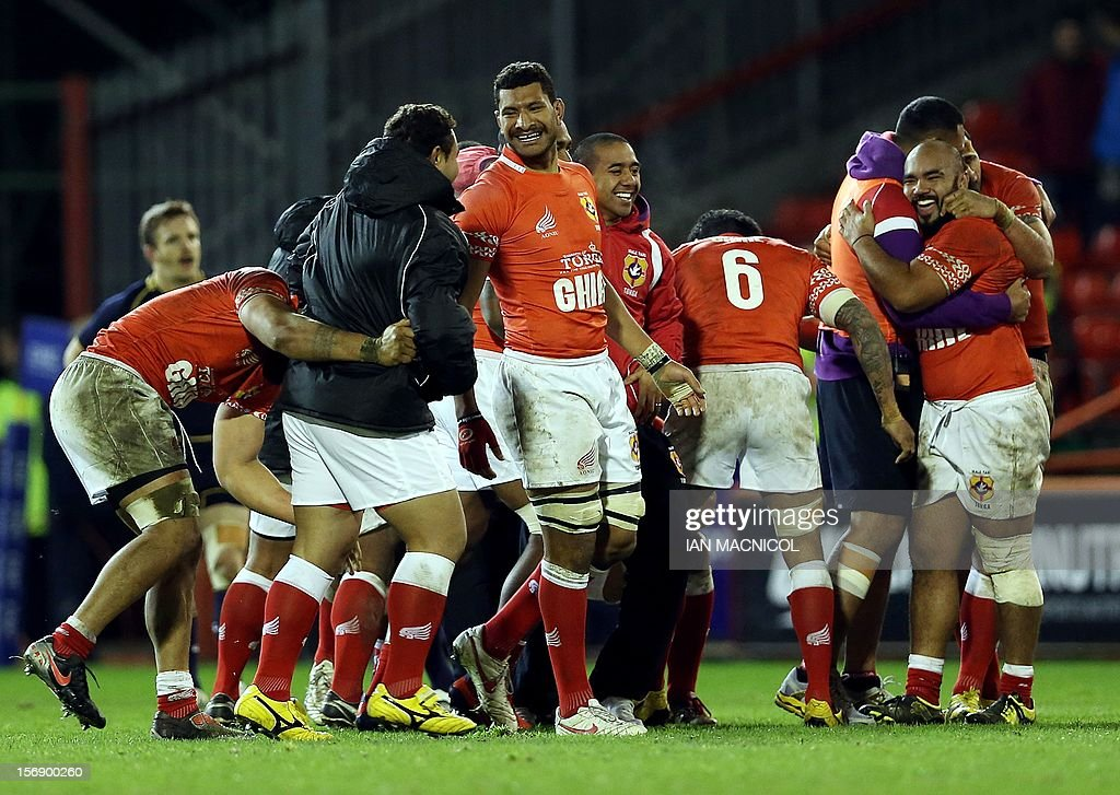 Tongan players celebrate victory at the final whistle during the International rugby union test match between Scotland and Tonga at Pittodrie in Aberdeen on November 24, 2012. Tonga beat Scotland 21-15.