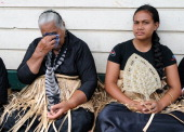 Tongan women mourn the loss of King George Tupou V during the royal funeral procession through the capital Nuku'alofa on March 27 2012 The death aged...