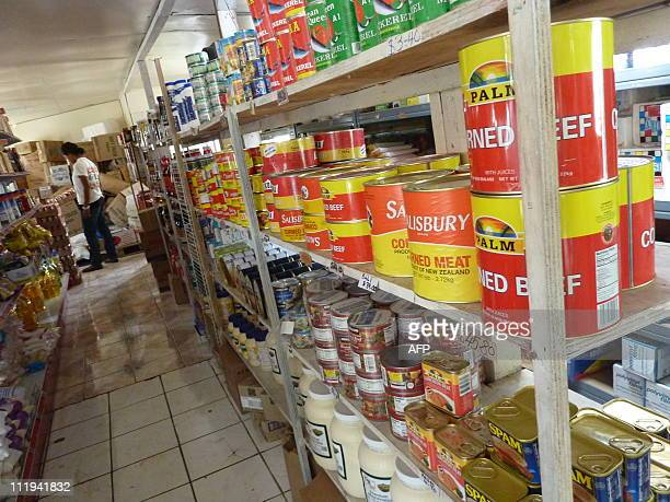 TongaPacifichealthlifestyleobesity FEATURE by Neil SandsThis picture taken on January 2 2011 shows large cans of corned beef on a supermarket shelf...