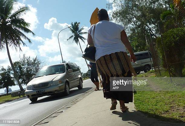 TongaPacifichealthlifestyleobesity FEATURE by Neil SandsThis picture taken on January 4 2011 shows pedestrians walking in a street in Nuku'alofa On...