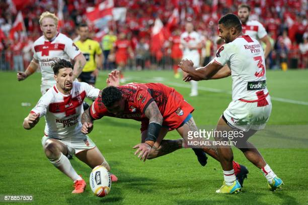 Tonga's Andrew Fifita dives on the ball after losing control of it during the Rugby League World Cup men's semifinal match between Tonga and England...