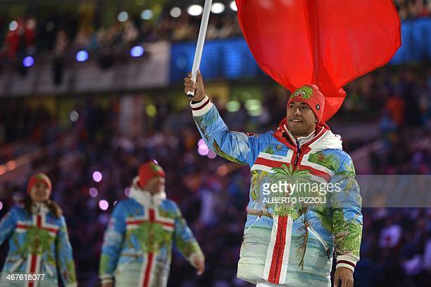 Tonga's flag bearer luger Bruno Banani leads his national delegation during the Opening Ceremony of the Sochi Winter Olympics at the Fisht Olympic...