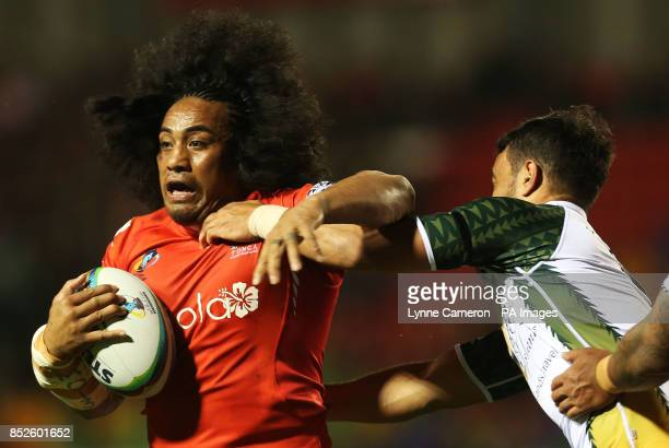 Tonga's Fuifui Moimoi and Cook Island's Issac John during the the 2013 World Cup match at Leigh Sports Village Leigh