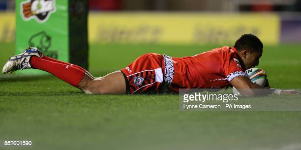 Tonga's Glen Fisiiahi scores a try during the the 2013 World Cup match at Leigh Sports Village Leigh