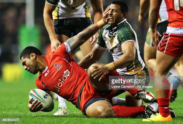 Tonga's Maha Fonua and Cook Island's Daniel Fepuleai during the the 2013 World Cup match at Leigh Sports Village Leigh