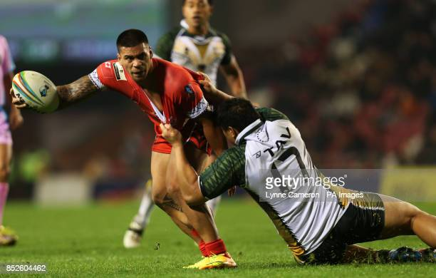 Tonga's Nafe Seluini and Cook Island's Sam Mataora during the the 2013 World Cup match at Leigh Sports Village Leigh