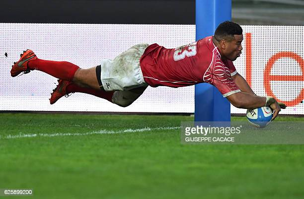 Tonga's Siale Piutau scores a try during the rugby union Test match between Italy and Tonga at the Euganeo Stadium in Padua on November 26 2016 / AFP...