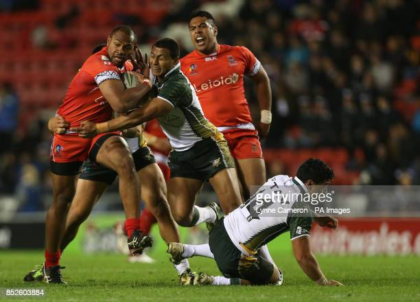 Tonga's Ukuma Taai and Cook Island's Keith Lulia and Hikele'o Malu during the the 2013 World Cup match at Leigh Sports Village Leigh