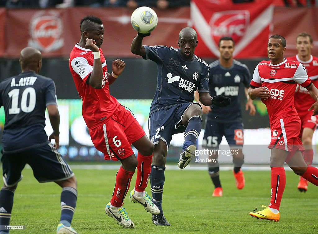 Tongo Doumbia of Valenciennes and <a gi-track='captionPersonalityLinkClicked' href=/galleries/search?phrase=Souleymane+Diawara&family=editorial&specificpeople=695613 ng-click='$event.stopPropagation()'>Souleymane Diawara</a> of OM in action during the French Ligue 1 match between Valenciennes FC and Olympique de Marseille OM at the Stade du Hainaut stadium on August 24, 2013 in Valenciennes, France.